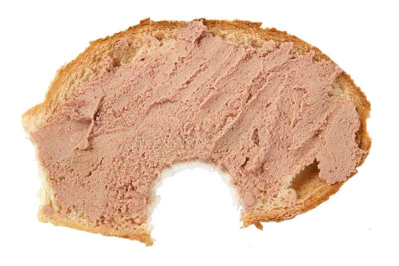Part de pain mordue avec le pâté photo stock