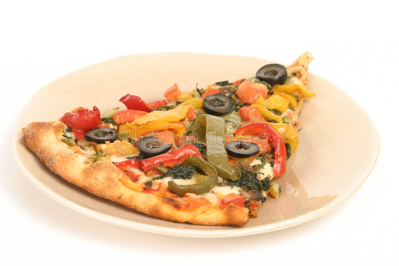 Part de pizza avec des légumes photo stock