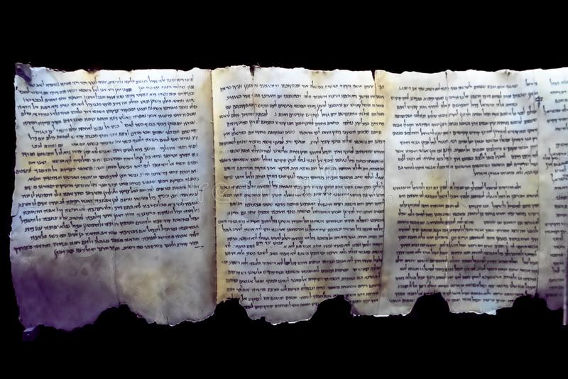 Part of the Dead Sea scrolls as exhibited in the museum Qumran, a settlement on the West Bank in Israel. Close-up of a portion of the Dead Sea scrolls as stock photography