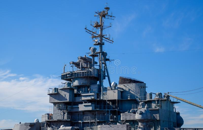 Part of the deck of a warship. communication devices and deck guns. Part of the deck of a warship. communication devices and deck guns royalty free stock photo