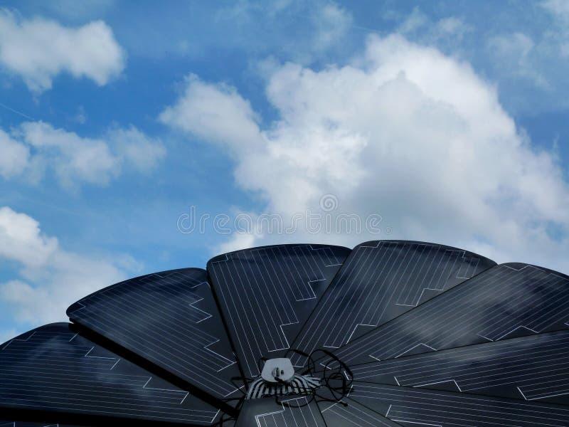 Sunflower shaped solar panel detail under blue sky royalty free stock photos