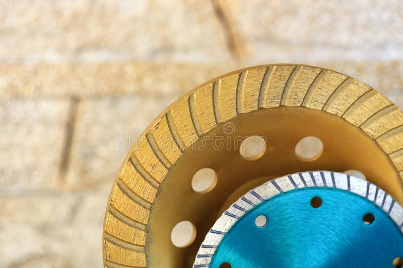 Part of the diamond grinding wheels on background an orange-golden sandstone wall stock photos