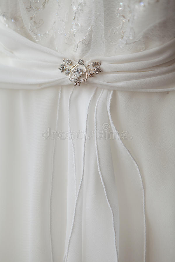 Part of a dress with brooch stock images