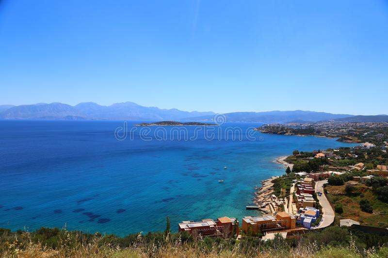 Part of the eastern cretan coast Greece near Elounda, panorama of part of the city and the ocean in Crete. royalty free stock photos