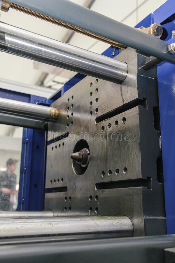 Part of extrusion manufacturing line - extruder, close up. View royalty free stock image