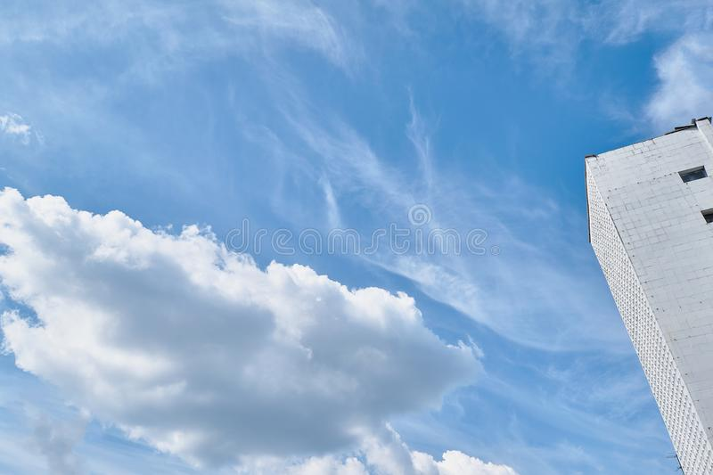 Fragment of a building against the sky. Part of the facade of the building against the sky royalty free stock photos