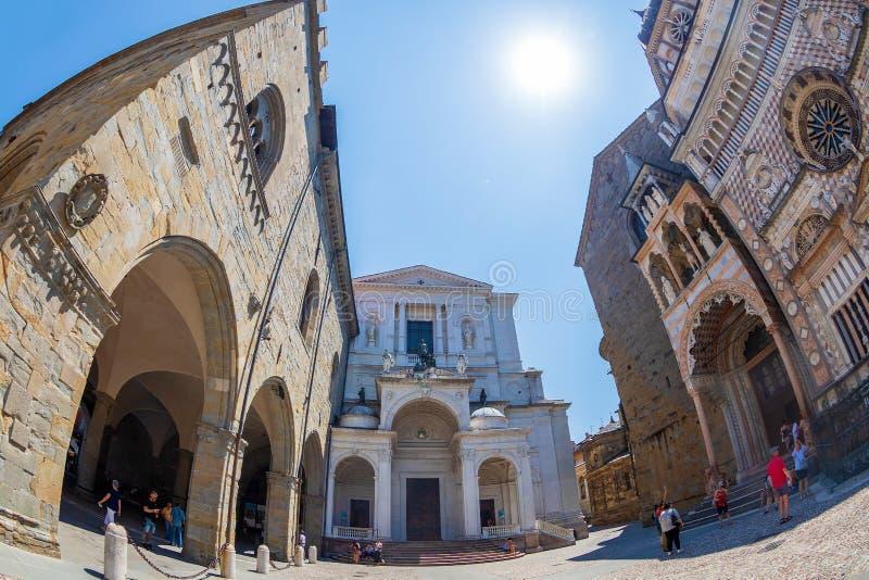 Part of churches facades in Piazza Duomo, Bergamo, Alta Citta, Italy. Part of facade from Cattedrale di Sant Alessandro, and Basilica of Santa Maria Maggiore in royalty free stock photos