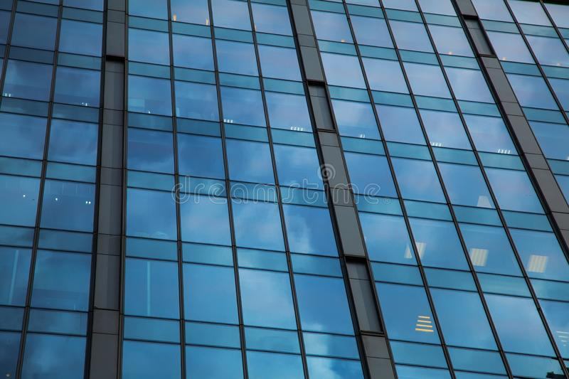 Part of the facade of a glass skyscraper. Modern architectural background of the city. Business center background royalty free stock photography