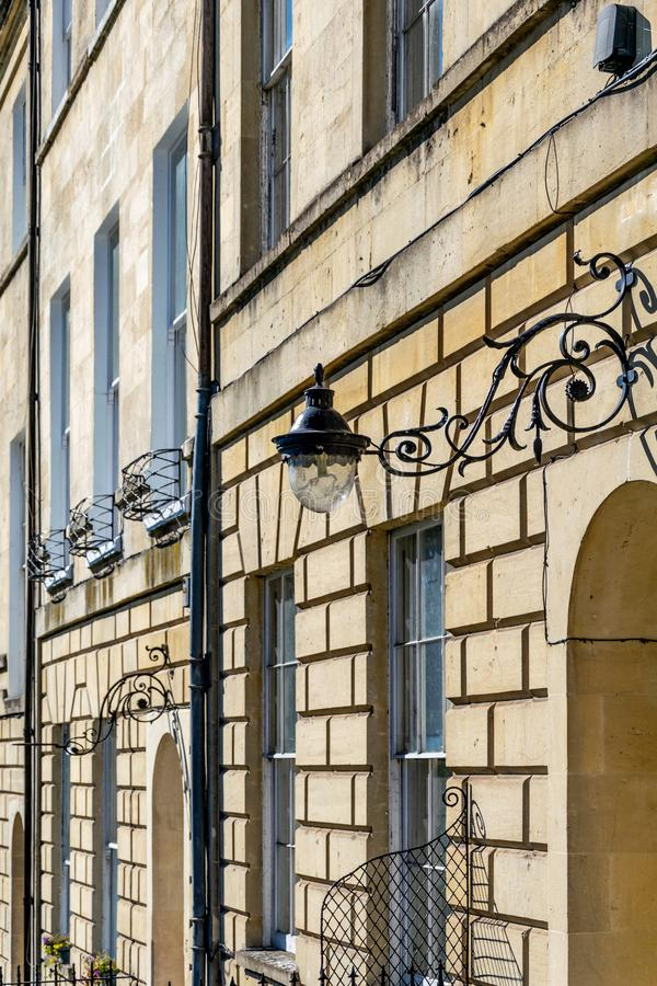 Part of the facade of Marlborough Buildings, Bath, England with a wrought iron lamp bracket. Mounted on the exterior wall royalty free stock images