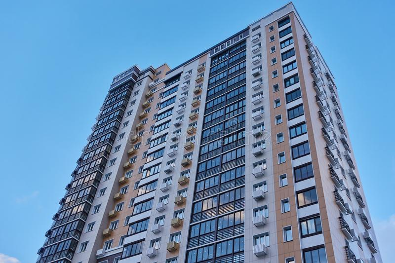Part of the facade of a multi-storey residential building against the sky.  stock images