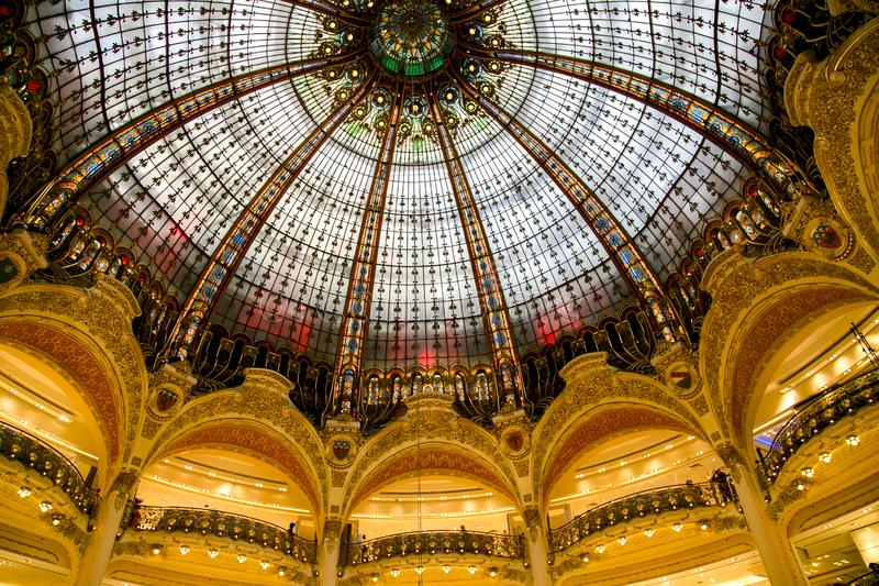 Part of the famous glass dome in the gallery La Fayette. The largest luxury department store in Paris.nModernist balconies in La Fayette department stores of stock photos