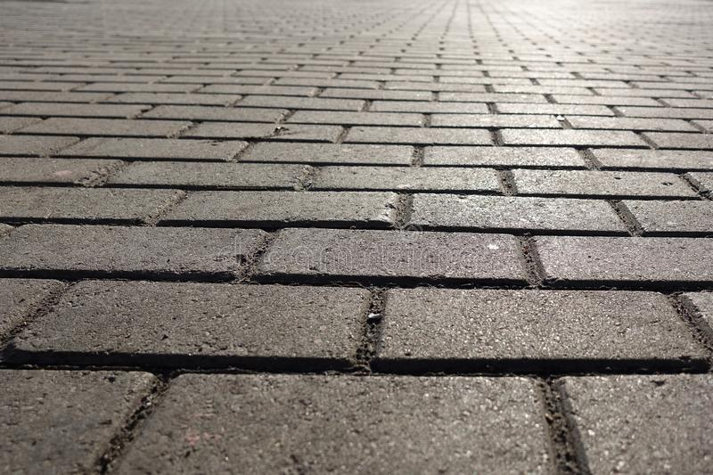 A part of footpath. Street tiled stone pavement. Background for design pattern artwork.  royalty free stock photo
