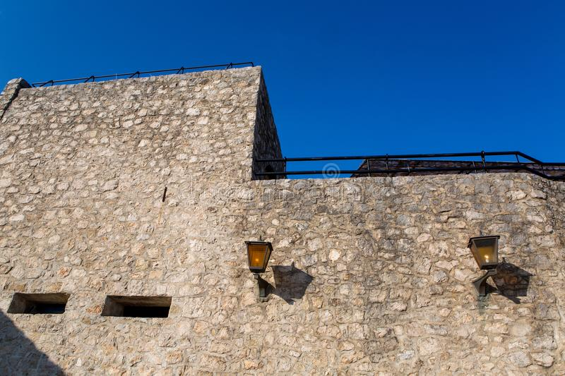 Part of the fortress wall with lanterns in Herceg Novi royalty free stock photography