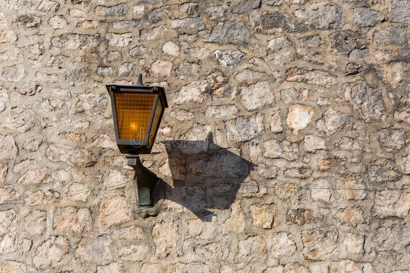 Part of the fortress wall with lanterns in Herceg Novi royalty free stock image