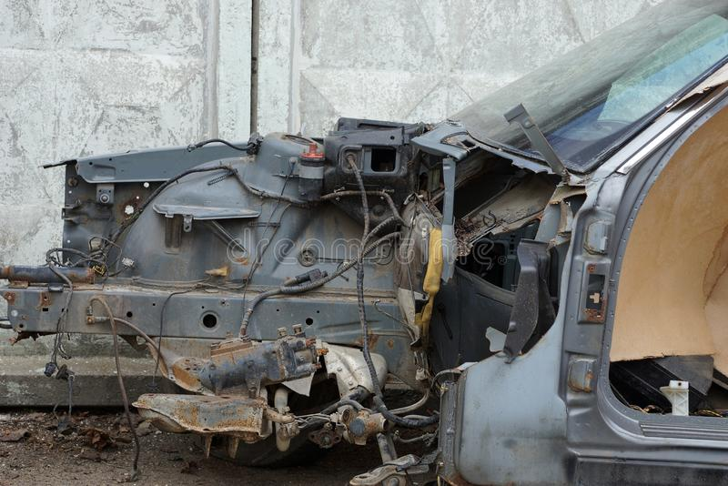Part of the frame of the old black car disassembled on the street royalty free stock photography