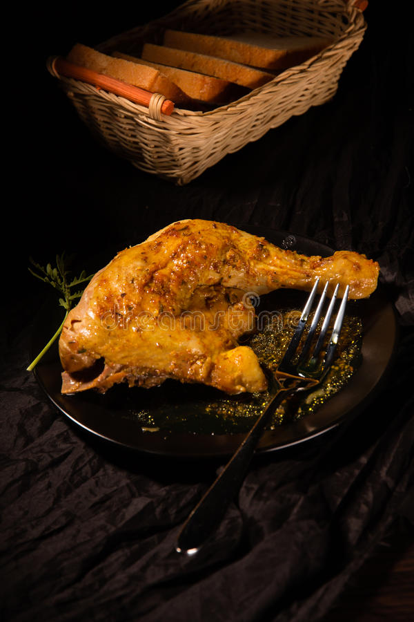 Part of fried chicken with spices stock photos
