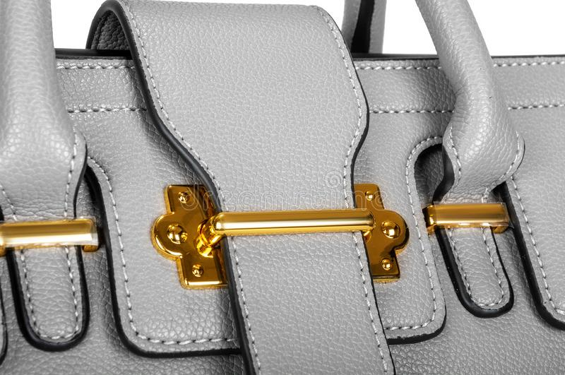 Part of a gray bag with golden details closeup stock photo
