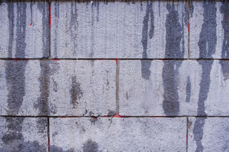 Part of gray grunge concrete wall with vertical flowing wet smudges. stock photography