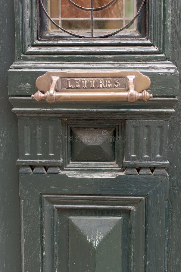 Part of greem wooden door stock image