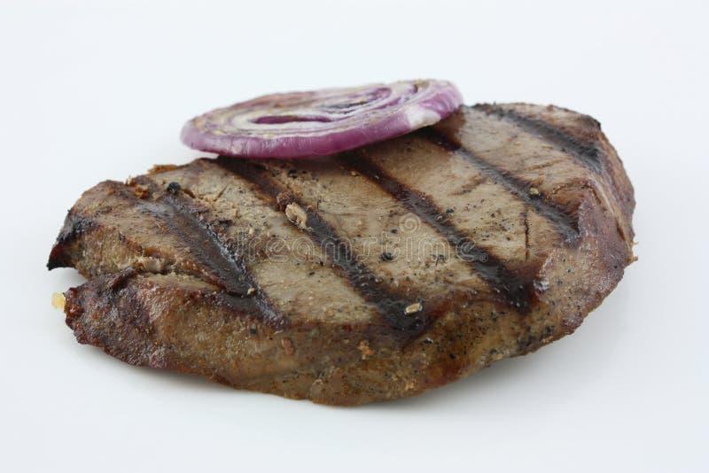 Part grillée de thon et d'oignon images stock