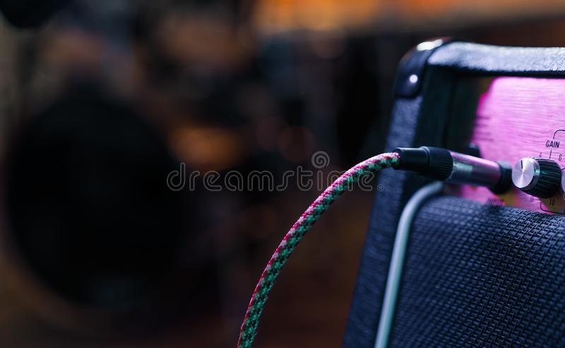 Part of guitar amp with plug in cable. Music concert or recording concept. Copy space stock photos