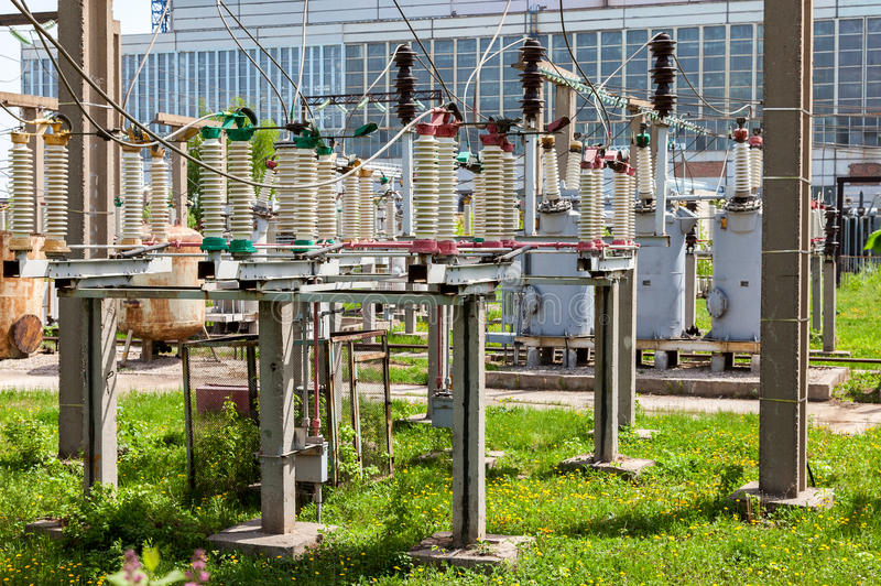 Part of high-voltage substation with switches. In summer sunny day royalty free stock images