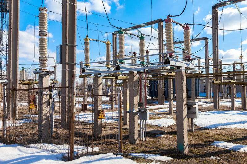 Part of high-voltage substation with switches. In sunny day royalty free stock photo