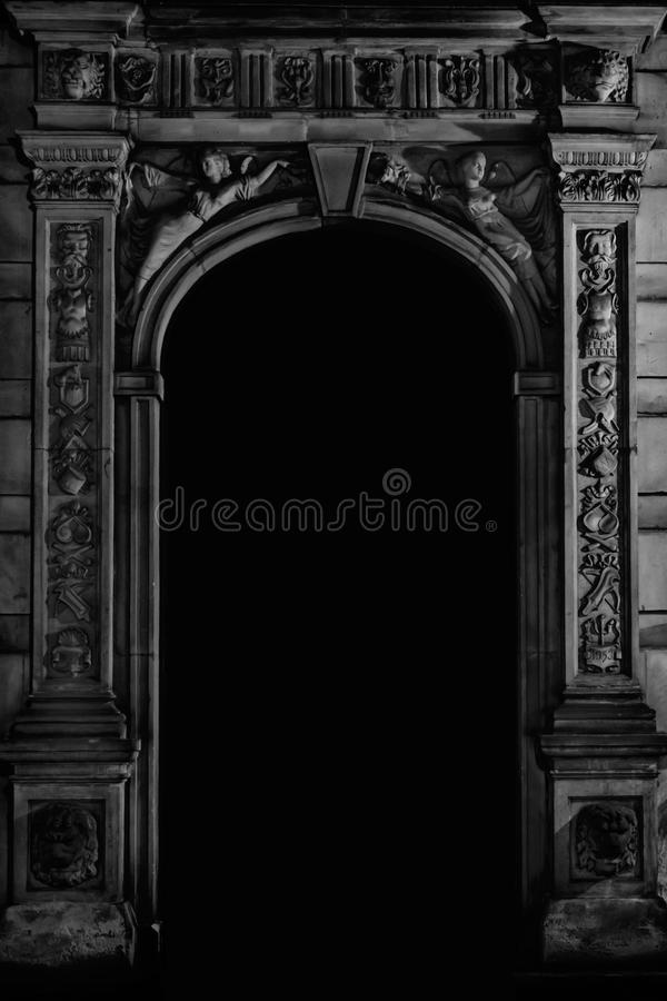 Archival dark gate. Part of historical architecture - richly decorated dark gate in archival building  B&W HDR intense effect stock photography
