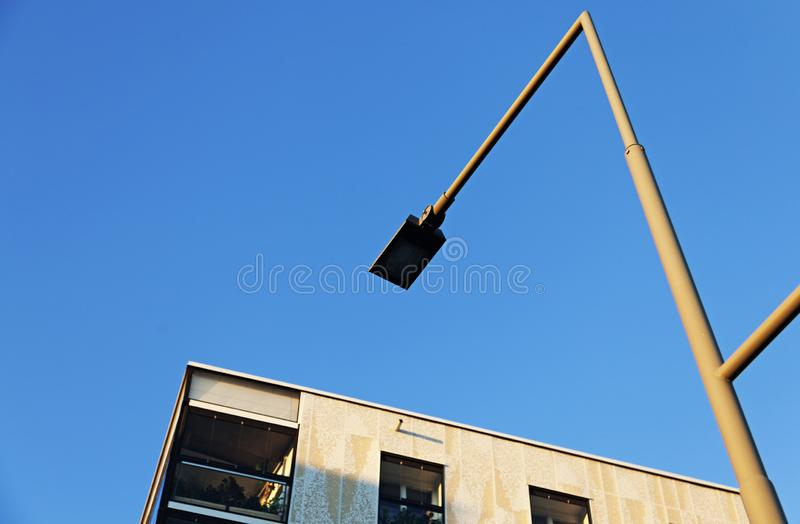 Part of house and lamp post from below royalty free stock photography