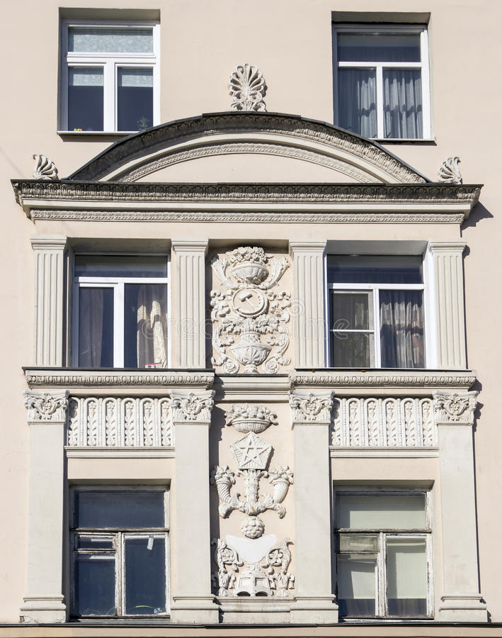 Part of house wall with soviet art fretwork. Part of house wall with beautiful soviet art fretwork stock photography