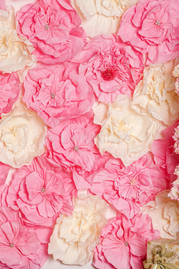 Part of the interior studio. Pink paper flowers stock images