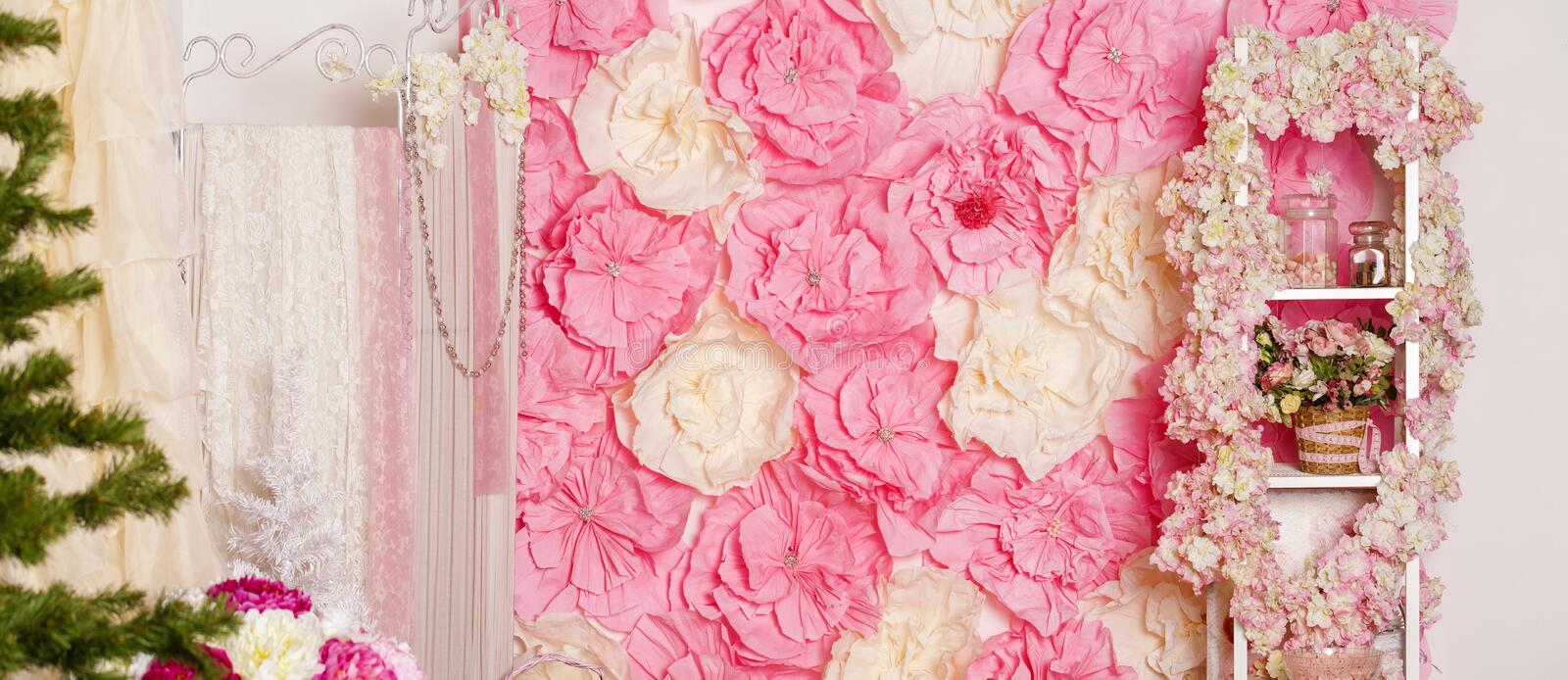 Part of the interior studio. Pink paper flowers stock photography