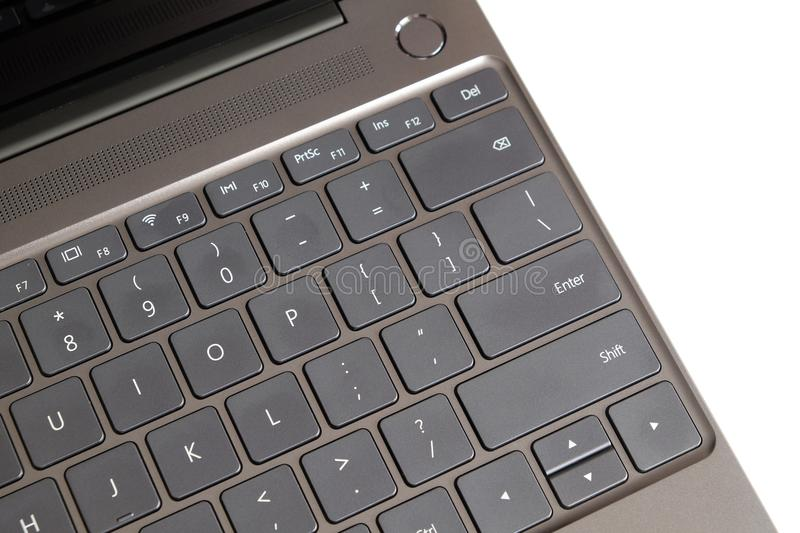 Part of laptop keyboard and touchpad of opened laptop isolated on white top view stock photo