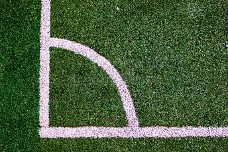 Part of the layout of the football field, the position of the corner kick. White marking lines on the green grass of the sports royalty free stock photo