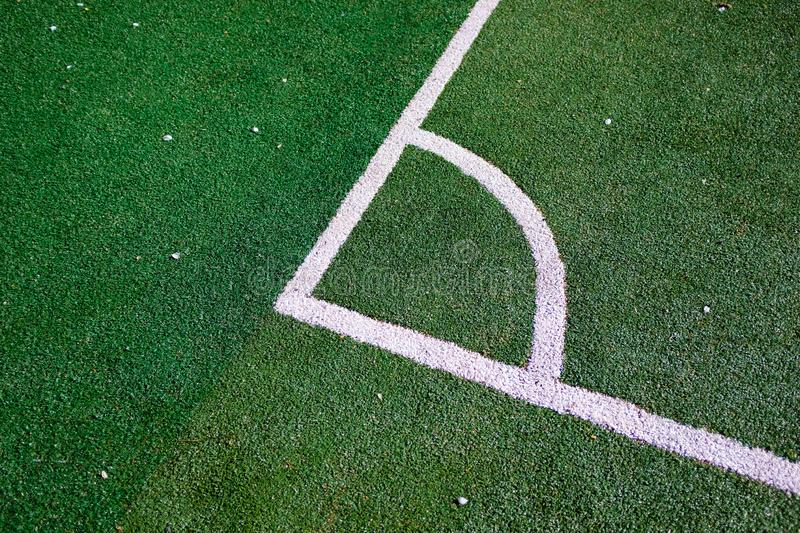Part of the layout of the football field, the position of the corner kick. White marking lines on the green grass of the sports royalty free stock images