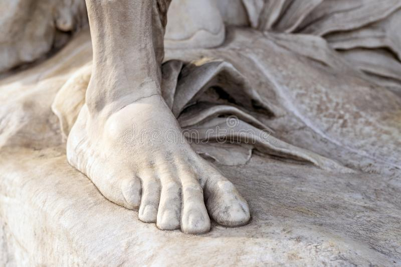 Part of leg of ancient marble statue. Close-up stone foot. Pedicure and feet care concept. Fungus mycotic infection onychomycosis disease bacteria fever royalty free stock photography