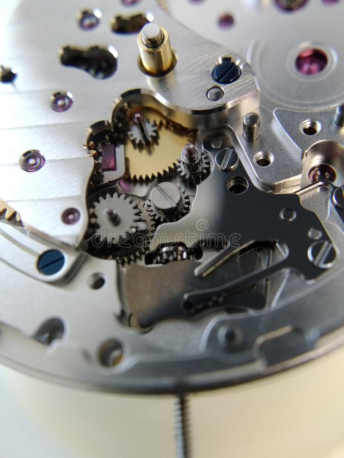 Part of the mechanism of a mechanical watch. Close-up of a mechanical gear stock image