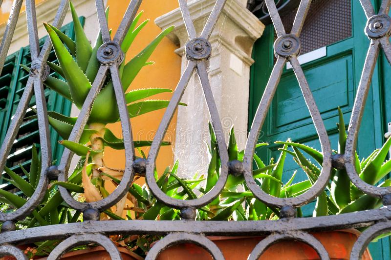 Part of metal decorative fence / Steel welding ornamental elements / Detail of modern architecture of Mediterranean style house i royalty free stock photos