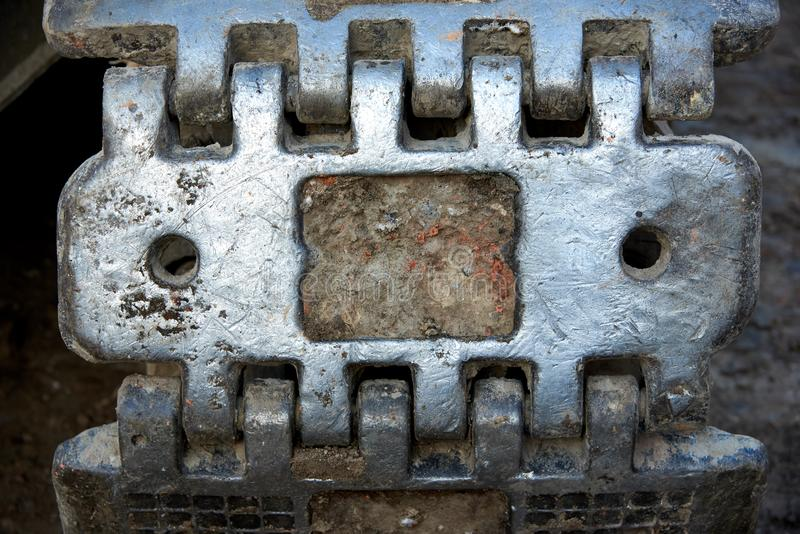 Part of a metal track. Close up. Metal track element of the construction bulldozer. Close up royalty free stock image