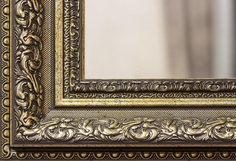 Part of the mirror frame. Part of the ornate, carved mirror frame in ancient style royalty free stock image
