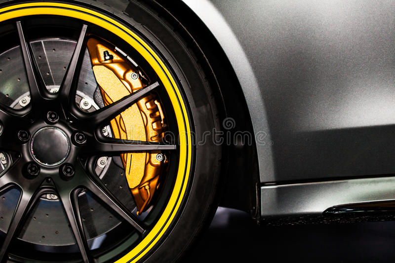 Part of modern new wheel car with disk brake pad.  royalty free stock image