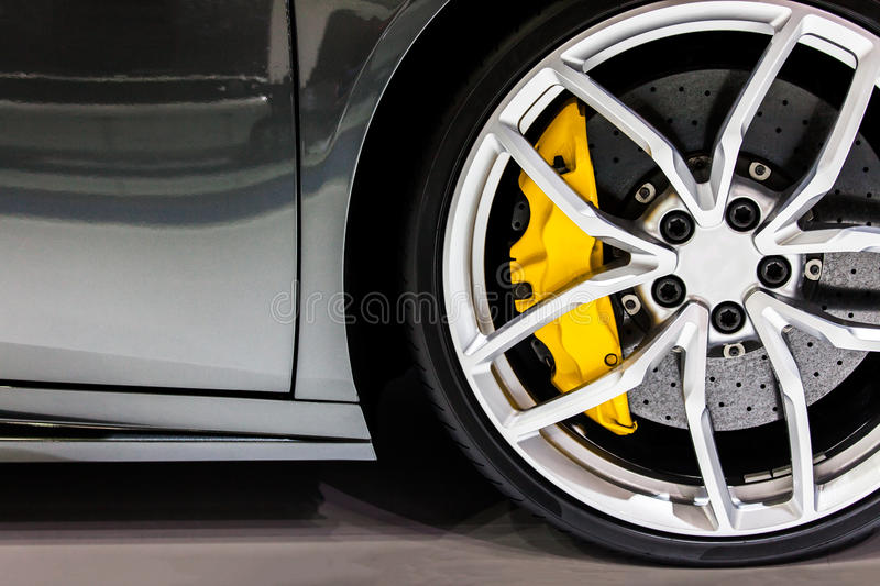 Part of modern new wheel car with disk brake pad.  stock images