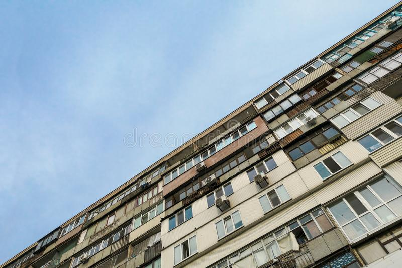Part of a multi-storey building against the sky. Residential building. A large multi-storey building in the city.  royalty free stock photography