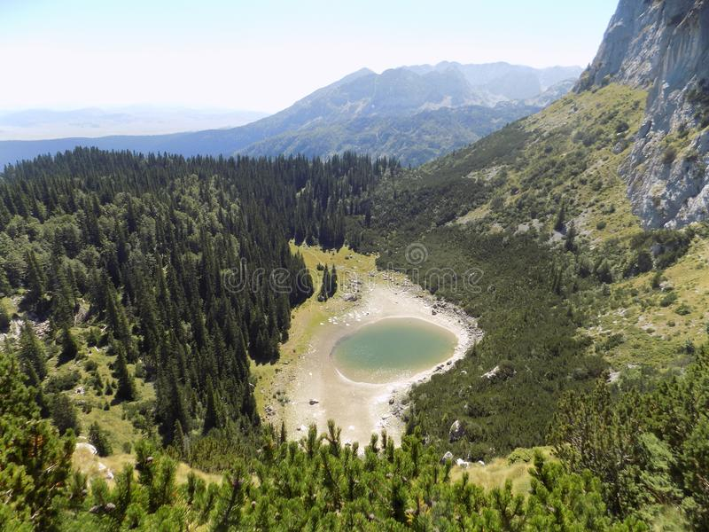 Part of the natural beauty of Durmitor - Jablan Lake - hidden in a beautiful mountain forest. One of the many beauties of the national park Durmitor in stock photography