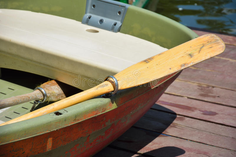 Part of a oar and boat. On the wooden pontoon stock photo