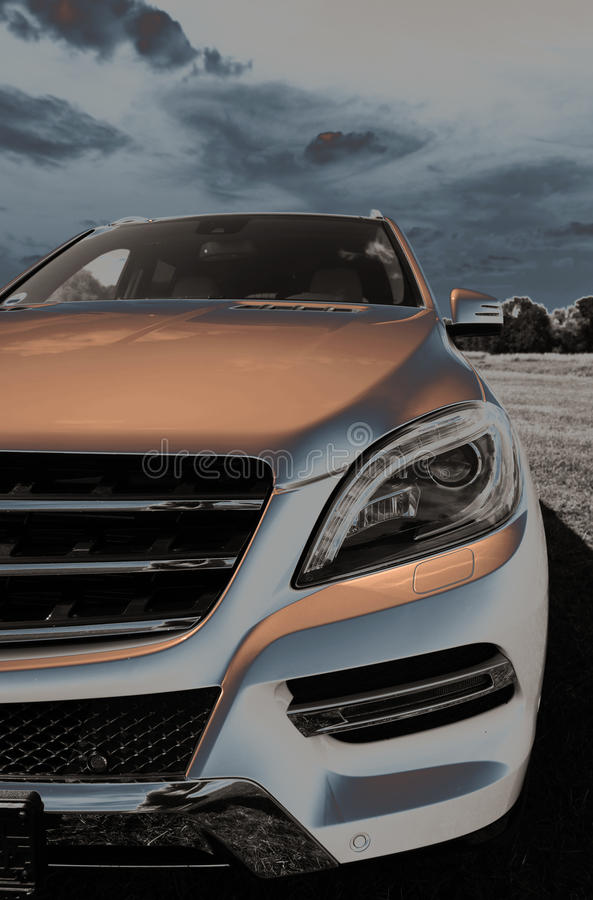 Free Part Of Mercedes ML, New SUV, Headlights, 2013 Stock Image - 34191291