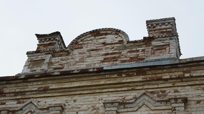 Part of an old brick building on a white sky background in Russia stock photos