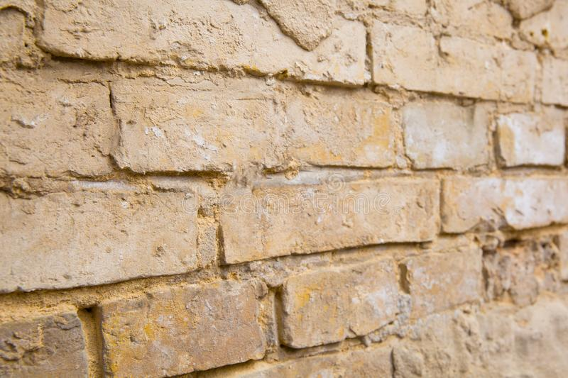 Part of old brick wall with crumbled plaster, close up stock photography
