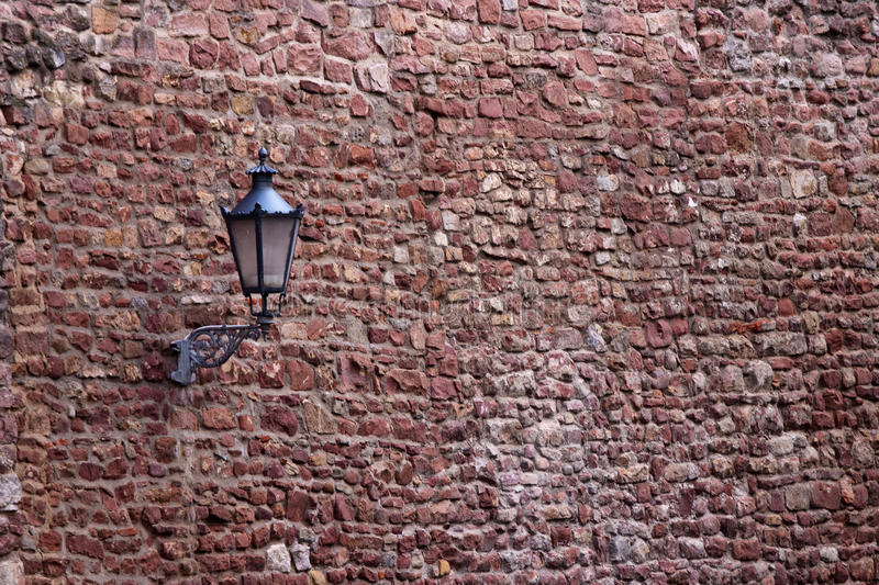 Part of the old city wall with lantern. In Ladenburg, Germany royalty free stock photo