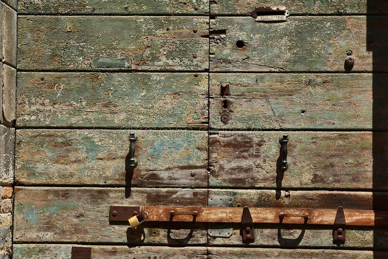 Part of the old, green painted, wooden doors royalty free stock photography
